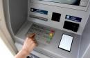 A woman's hand using a cash machine (ATM)