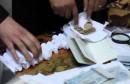monnaie falsifier  عملة مزورة