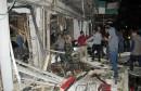 842277-des-personnes-sur-les-lieux-d-un-attentat-a-l-est-de-bagdad-le-11-janvier-2016