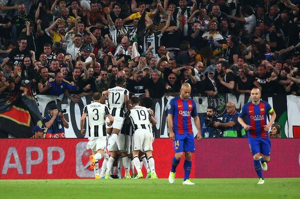 Juventus-Paulo-Dybala-celebrates-scoring-their-first-goal-with-team-mates-as-Barcelonas-Javier-Mas