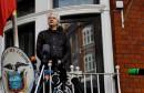 FILE PHOTO: FILE PHOTO: WikiLeaks founder Julian Assange is seen on the balcony of the Ecuadorian Embassy in London